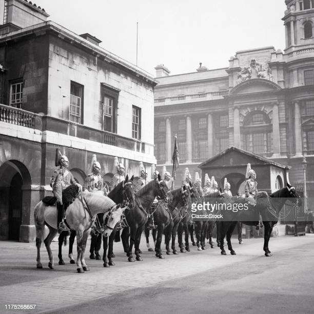 1930s THE QUEENS LIFE GUARDS ON HORSES ALL RIDE BLACK HORSE EXCEPT THE TRUMPETER WHO RIDES A GRAY WHITEHALL LONDON ENGLAND UK