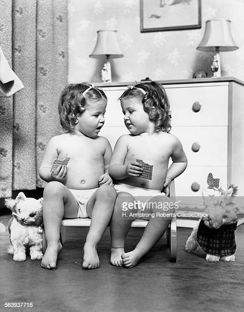 1930s TWIN GIRLS SITTING...