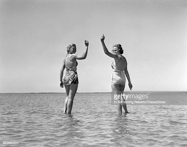 1930s TWO GIRLS STANDING...
