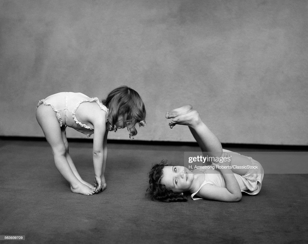1930s TWO GIRLS WEARING... : Stock Photo
