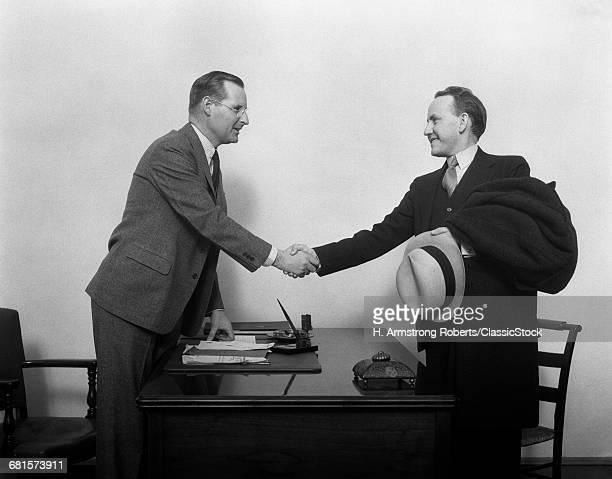 1930s TWO MEN SHAKING...
