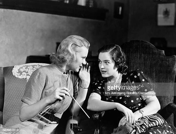1930s TWO WOMEN SITTING IN...