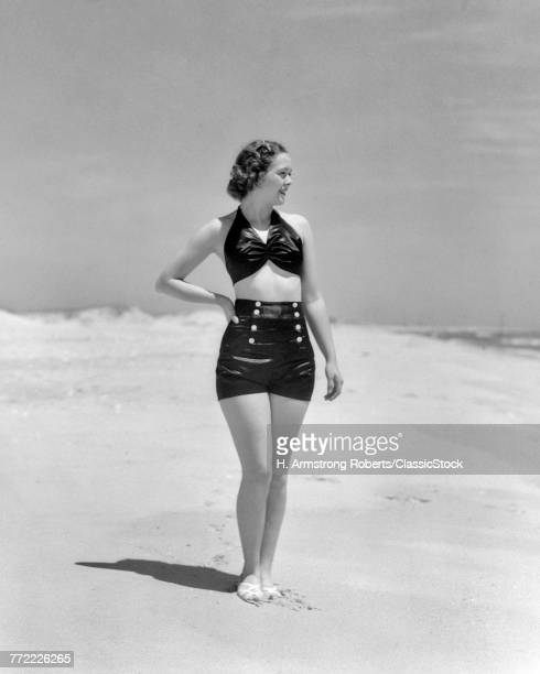 1930s WOMAN STANDING ON...