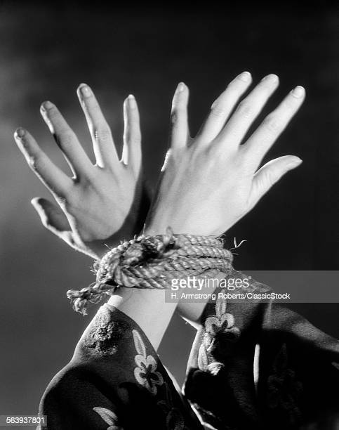 1930s WOMAN'S HANDS TIED...