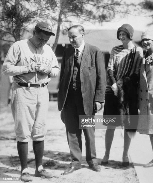 Clarence Darrow watching Babe Ruth affix his signature on a baseball. Filed 1931.