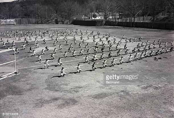 Ray Doans' Baseball School Entire school taking settingup excercises