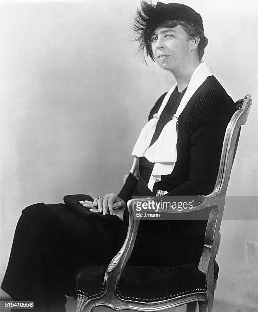 1933Portrait of Eleanor Roosevelt seated in a chair wearing a feathered hat