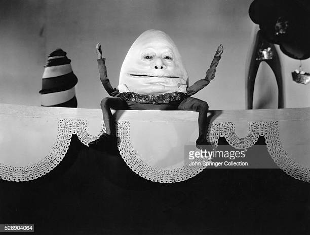 Fields as Humpty Dumpty sitting on the wall in Lewis Carroll's Alice in Wonderland directed by Norman McLeod