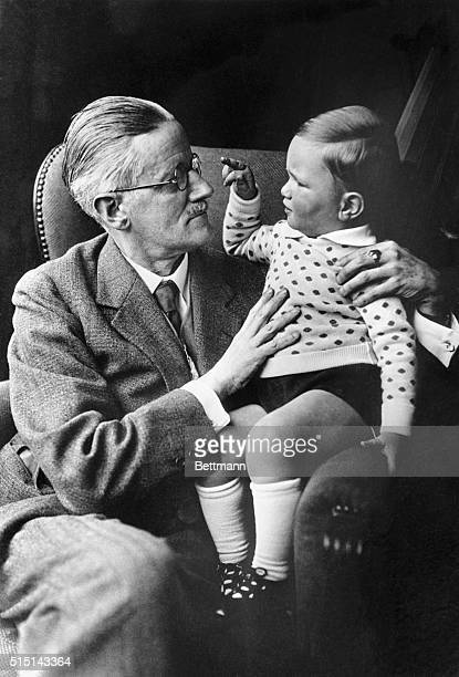 1934Author James Joyce is shown with his grandchild Stephen James