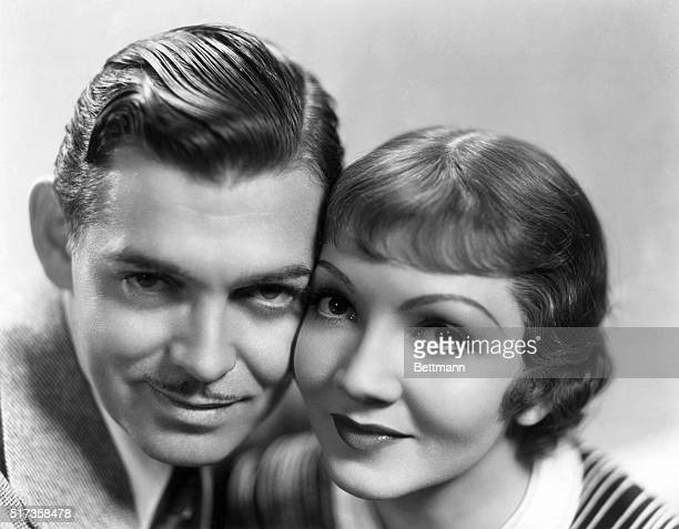 1934Clark Gable and Claudette Colbert pose for a publicity photo for Columbia's It Happened One Night directed by Frank Capra They pose cheek to...