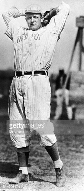 Christy Mathewson, famous New York Giants baseball pitcher, is shown about to pitch the ball.