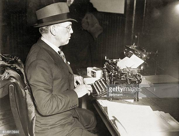 1935Damon Runyon American journalist and writer is shown typing at a typewriter Picture taken at Flemington NJ