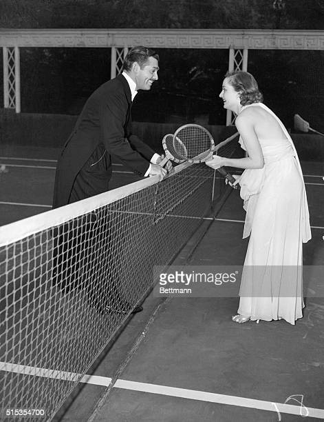 1935Hollywood CA An informal picture of Clark Gable and Carole Lombard playing tennis in formal evening attire in Hollywood recently Today the screen...