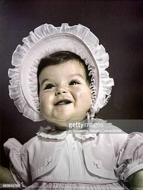 1940s 1950s BABY BRUNETTE PORTRAIT WEARING WHITE RUFFLED DRESS BIG BONNET HAT