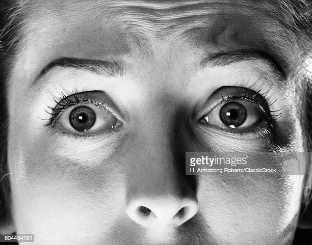 1940s 1950s CLOSEUP WOMAN'S EYES SHOWING FEAR