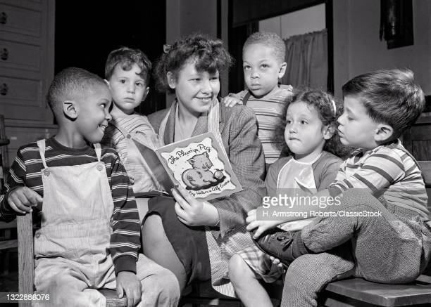 1940s 1950s Ethnically Diverse Students Seeing & Hard Of Hearing School Philadelphia Pa Teacher Reading Book 'The Plump Pig'.