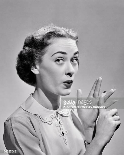 1940s 1950s Expressive Woman Pursed Lips Raised Eyebrows Looking At Camera Counting Off Argument Points And Facts On Fingers