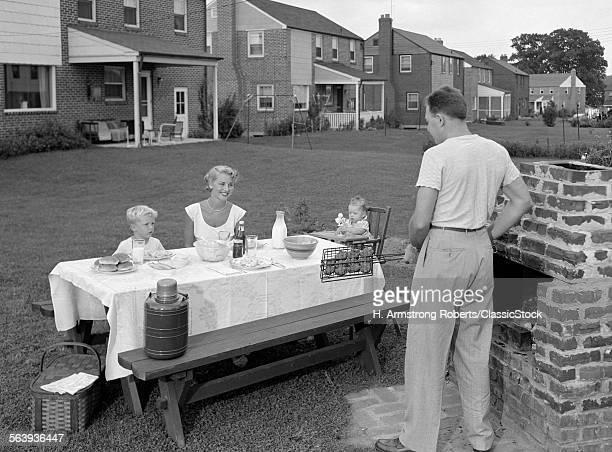 1940s 1950s FAMILY IN BACKYARD COOKING HAMBURGERS