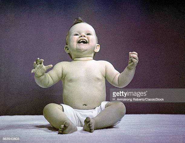 1940s 1950s FULL BODY SITTING BABY LAUGHING HANDS ARMS RAISED