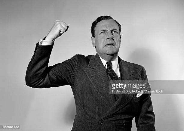 1940s 1950s MAN RAISING...