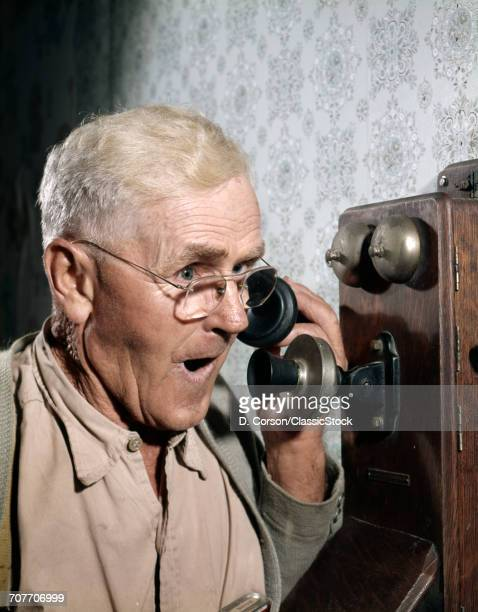 1940s 1950s MAN USING OLD-F...
