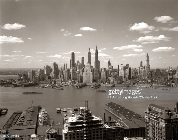 1940s 1950s NYC DOWNTOWN NEW YORK CITY SKYLINE ACROSS EAST RIVER FROM BROOKLYN
