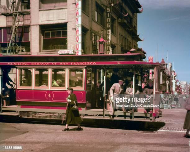 1940s 1950s Passengers Riding Cable Car At Entrance To Chinatown At California And Grant Streets San Francisco Ca USA.