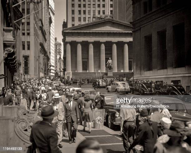 1940s 1950s PEDESTRIANS ON SIDEWALK AND AUTOMOBILE TRAFFIC IN FRONT OF STOCK EXCHANGE BUILDING WALL STREET NEW YORK CITY USA