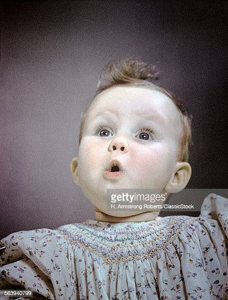 1940s 1950s PORTRAIT BABY CUTE FACIAL EXPRESSION OF AWE WONDER SURPRISE