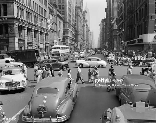 1940s 1950s STREET SCENE CROWDS TRAFFIC INTERSECTION FIFTH AVENUE 14 STREET MANHATTAN NY NEW YORK CITY