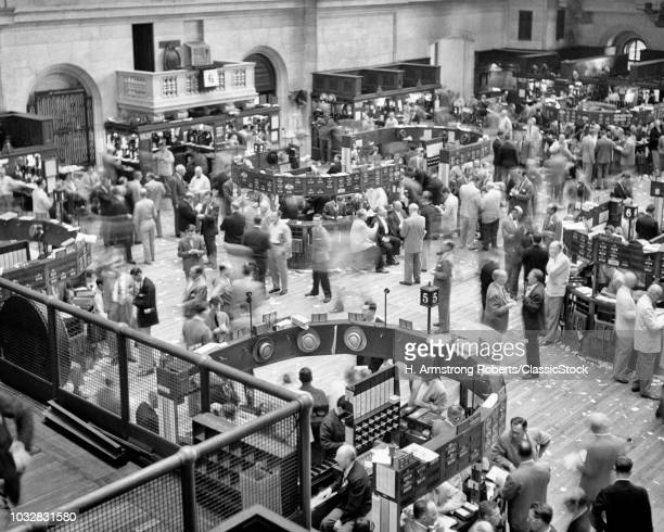 1940s 1950s TRADERS ON FLOOR OF NEW YORK STOCK EXCHANGE MANHATTAN NYC USA