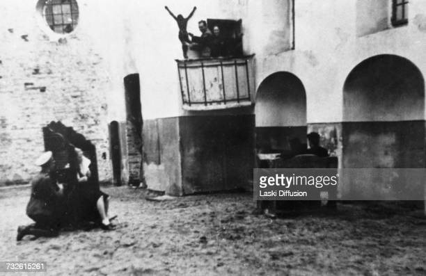 A desecration Germans indulging in horseplay in a church in keeping with their programme to eradicate the Catholic church from the culture in...