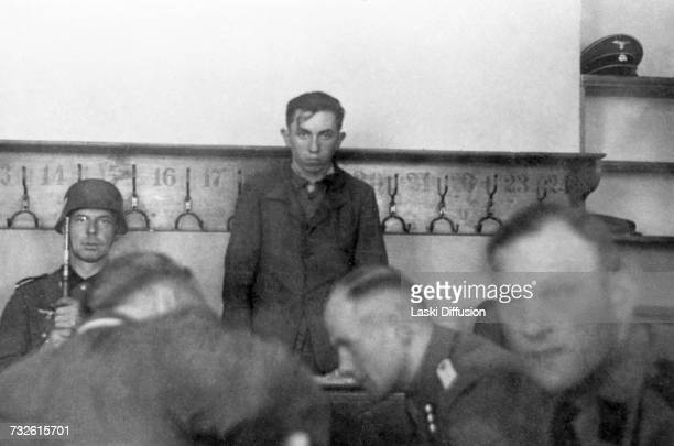 An accused in a martial law court in Kutno Germanoccupied Poland circa 1942 A photo from an album documenting German atrocities in occupied Poland...