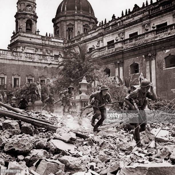 1940s AUGUST 5 1943 BRITISH SOLDIERS 8TH ARMY RUNNING OVER RUBBLE RUINS IN CATANIA SICILY ITALY