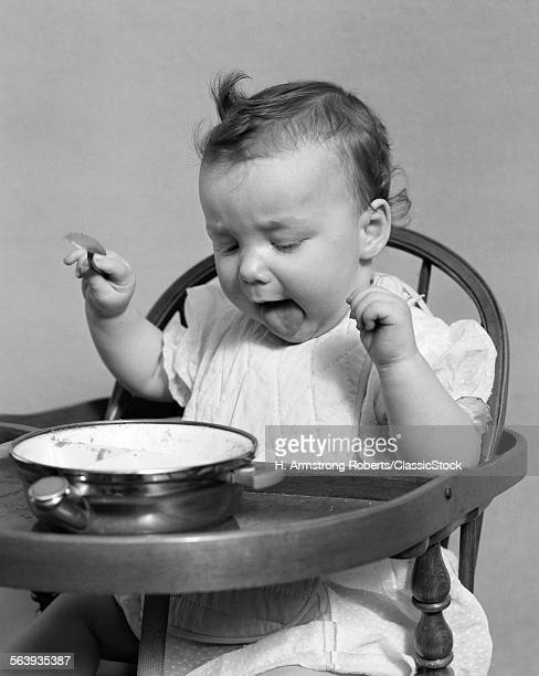 1940s BABY GIRL EATING...