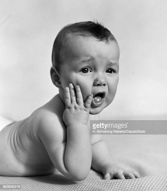 1940s BABY LYING ON...