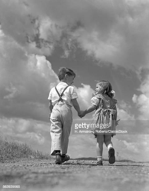 1940s BOY GIRL HOLDING...
