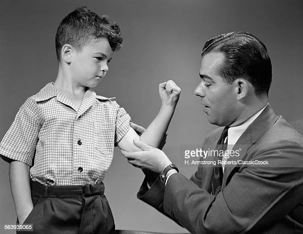 1940s BOY MAKES MUSCLE FOR MAN FATHER