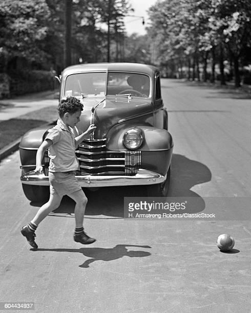 1940s BOY RUNNING AFTER.