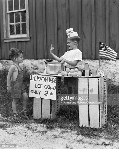 1940s BOY RUNNING LEMONADE...