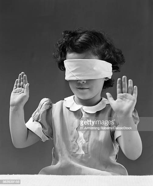 1940s CHILD WEARING BLIND...