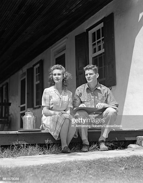 1940s COUPLE SITTING PORCH...