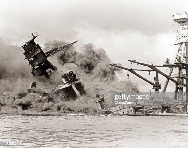 1940s DECEMBER 7 1941 BATTLESHIP USS ARIZONA BURNS SINKS DARK CLOUD OF SMOKE AFTER ATTACK BY JAPANESE PEARL HARBOR HAWAII USA