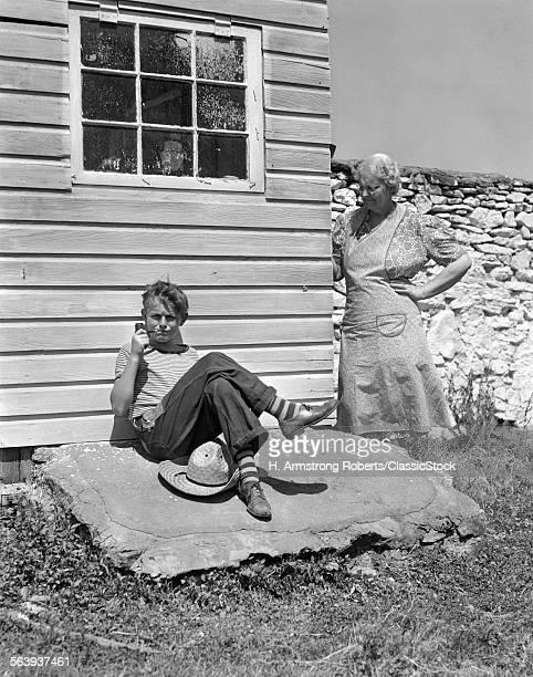 1940s FARM BOY LEANING...