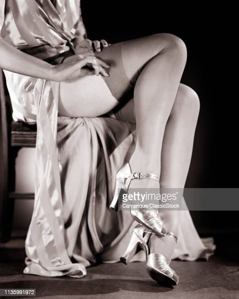 1940s FEMALE LEGS PUTTING ON SILK HOSIERY STOCKINGS