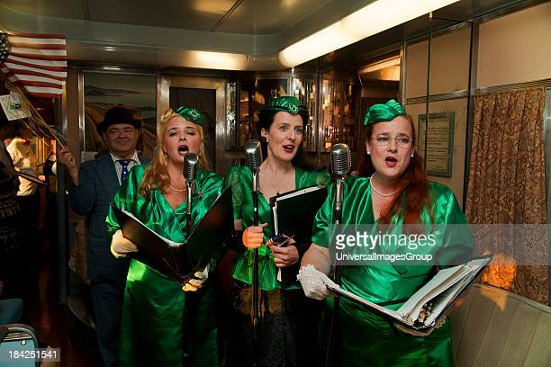 1940s female reenactors sing on Pearl Harbor Day Troop train reenactment from Los Angeles Union Station to San Diego