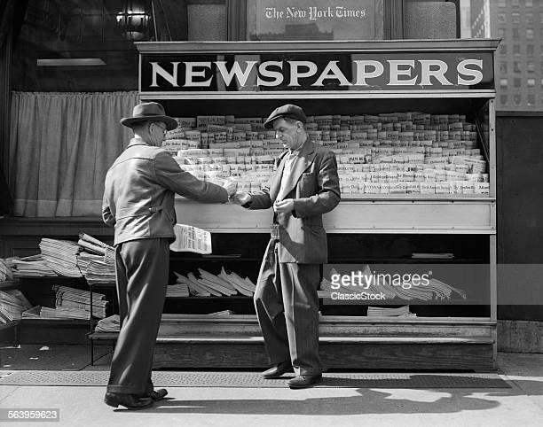 1940s MAN BUYING NEWSPAPER...