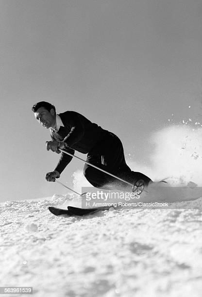 1940s MAN DOWNHILL SKIING...