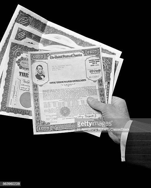 1940s MAN HAND HOLDING...