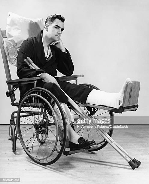 1940s MAN IN WHEELCHAIR...